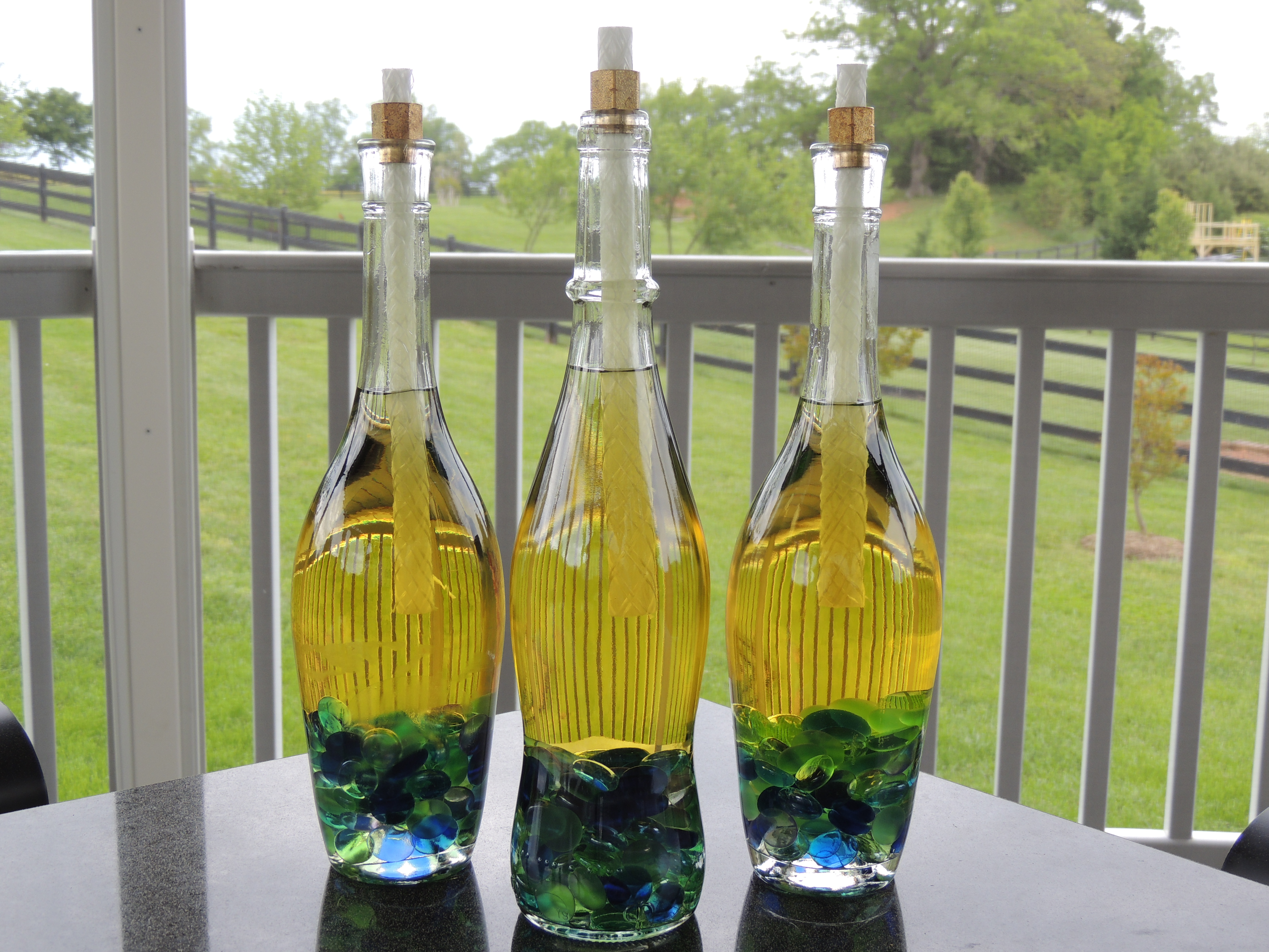 What to do with empty wine bottles - Wine Bottle Tiki Torches