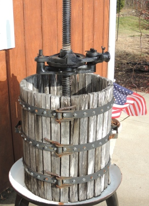 I love the flag peeking out from behind this old wine press.